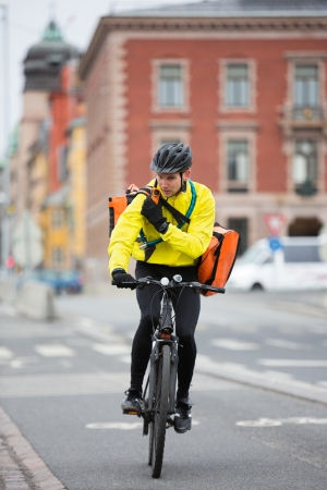 two way: Cyclist With Courier Bag Using Walkie-Talkie