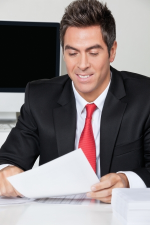 Businessman Reading Document In Office Stock Photo - 16470577