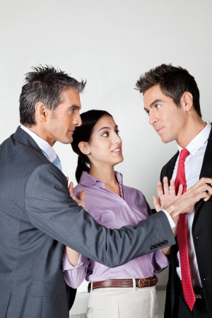 Businesswoman Acting As Peacemaker Between Colleagues Stock Photo - 16470576