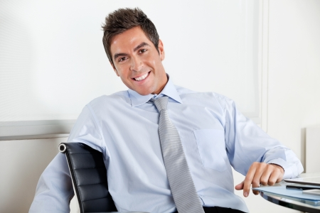 Handsome Young Businessman Smiling Stock Photo - 16470513