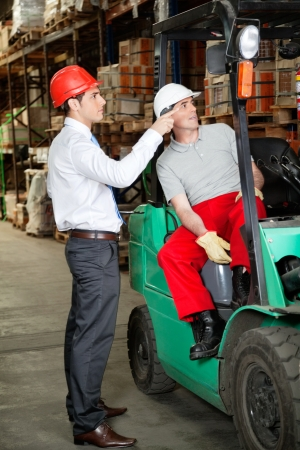 instructing: Supervisor Instructing Forklift Driver