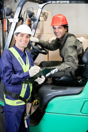 Portrait Of Forklift Driver And Supervisor photo