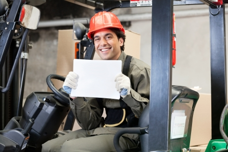 Forklift Driver Displaying Blank Placard Stock Photo - 16470556