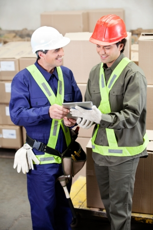 Foremen Using Digital Tablet in Warehouse photo