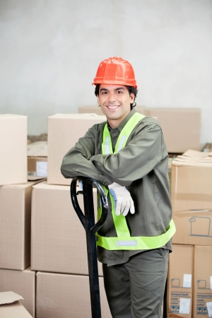 leaning on the truck: Foreman Standing At Warehouse