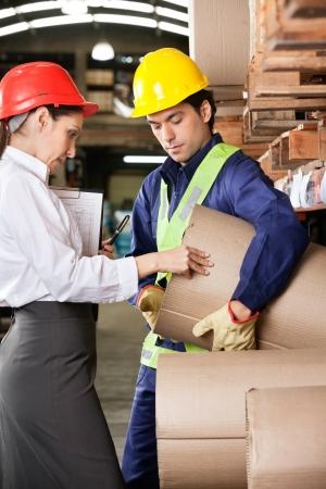 Supervisor And Foreman Checking Cardboard At Warehouse Stock Photo - 16470555