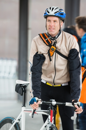 Young Male Cyclist With Backpack photo