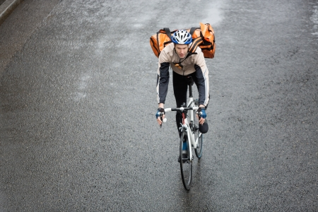 Male Cyclist With Backpack On Street photo