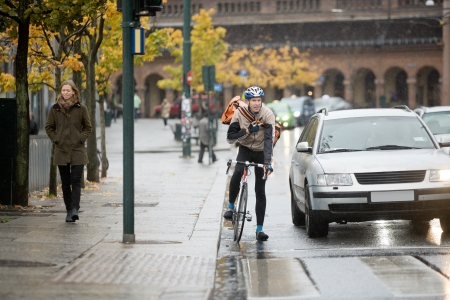 Male Cyclist Using Walkie-Talkie On Street photo