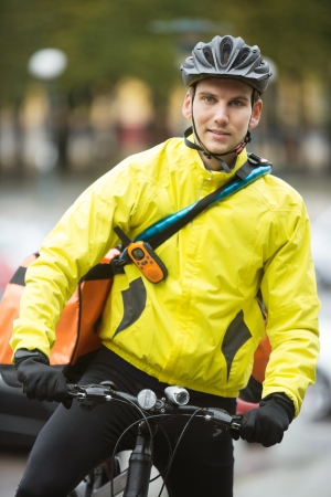 Young Male Cyclist With Courier Delivery Bag On Street Stock Photo - 16470570