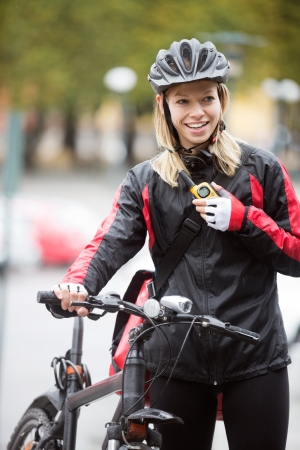 talkie: Female Cyclist With Courier Bag Using Walkie-Talkie