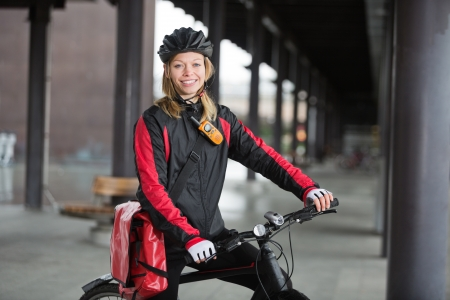 Female Cyclist With Courier Bag photo