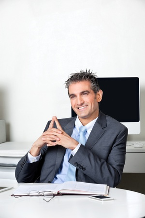 Thoughtful Happy Businessman At Desk Stock Photo - 16487156