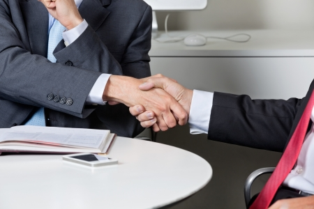 Midsection Of Businessmen Shaking Hands Stock Photo - 16492618