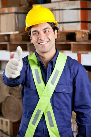 Confident Foreman Gesturing Thumbs Up photo