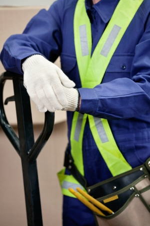 Midsection Of Young Foreman In Protective Clothing photo
