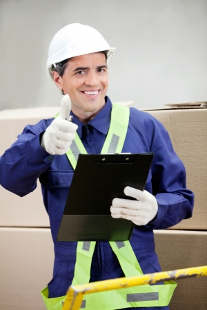 Supervisor With Clipboard Gesturing Thumbs Up Stock Photo - 16487158
