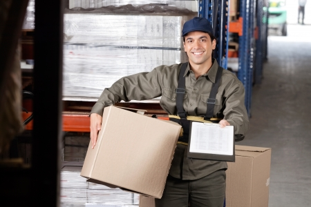 Male Supervisor With Clipboard And Cardboard Box Stock Photo - 16489827