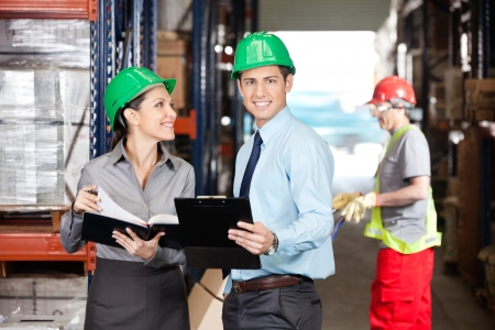 Supervisors And Foreman Working At Warehouse Stock Photo - 16489826