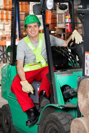 Mid Adult Forklift Driver At Warehouse Stock Photo - 16489836