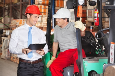 Supervisor Communicating With Forklift Driver photo