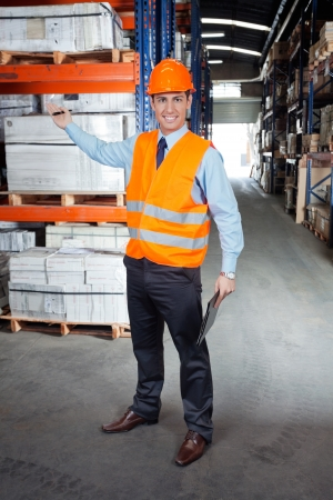 Confident Supervisor Showing Stock On Shelves Stock Photo - 16489825