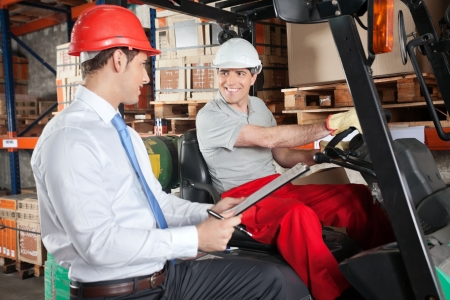 Forklift Driver Communicating With Supervisor photo