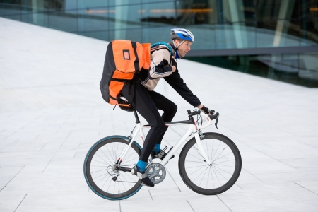 Male Cyclist With Backpack Riding Bicycle photo