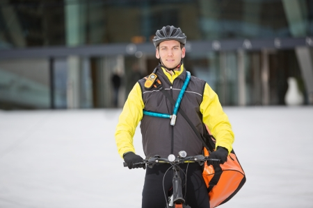 Male Cyclist Carrying Courier Delivery Bag photo