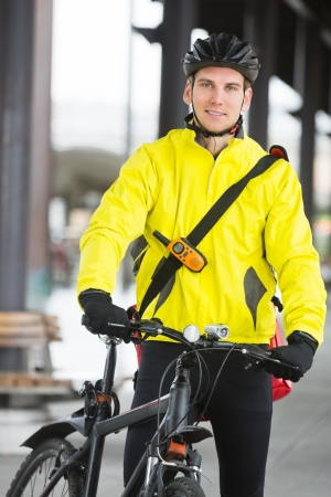 Young Man In Protective Gear With Bicycle photo