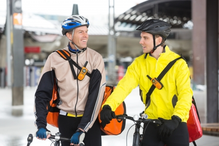 Courier Delivery Men With Bicycles Looking At Each Other Stock Photo - 16489862