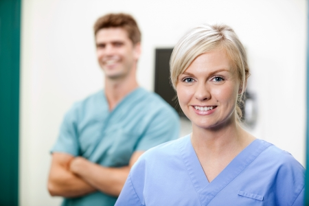 male nurse: Young Female Vet In Scrubs Smiling