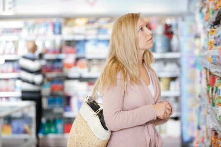 Young Woman Shopping At Supermarket Stock Photo - 16660926