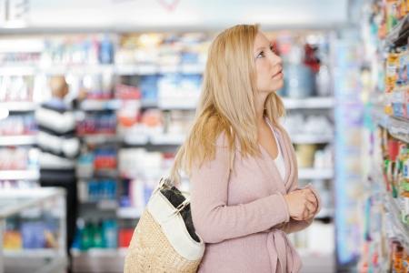 Young Woman Shopping At Supermarket Stock Photo - 16660926