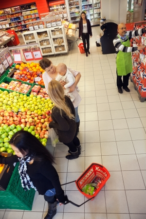 People Shopping In A Supermarket photo