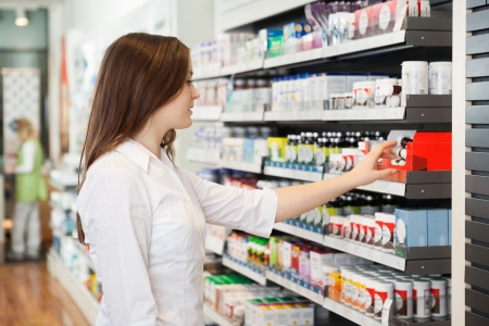 drug store: Young Female Pharmacist Stock Photo