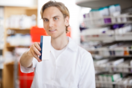 Pharmacist Holding Medicine photo