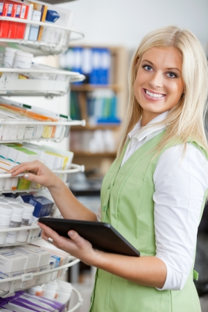 Young Blond Pharmacist Using Digital Tablet photo