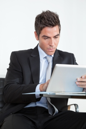 Young Businessman Using Digital Tablet In Office Stock Photo - 16672683