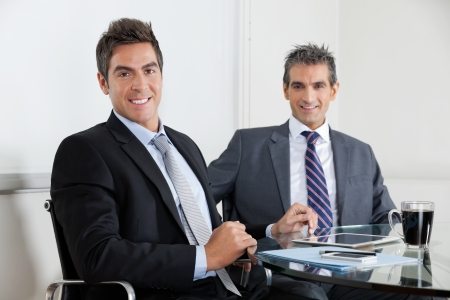 Businessmen Using Digital Tablet In Office photo