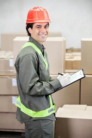 Supervisor Writing Notes At Warehouse Stock Photo - 16672692