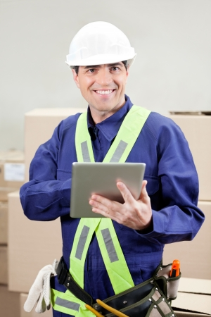 Foreman Using Digital Tablet At Warehouse Stock Photo - 16672681