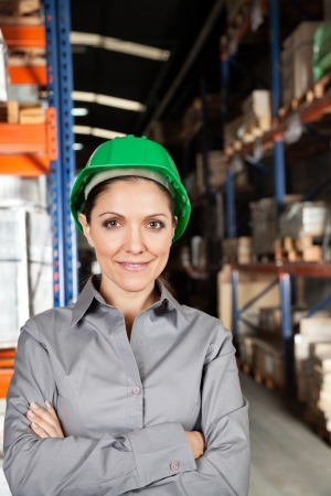 Female Supervisor With Arms Crossed At Warehouse Stock Photo - 16672702