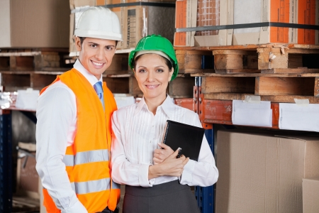 Confident Young Supervisors At Warehouse photo