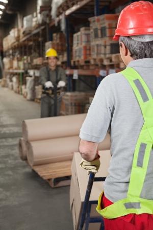 handtruck: Warehouse Workers Pushing Handtruck