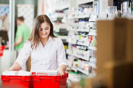 health professionals: Pharmacist Stocking Shelves in Pharmacy