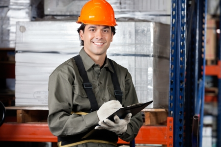 Young Male Supervisor With Clipboard Smiling Stock Photo - 16715229