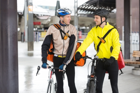 Courier Delivery Men With Bicycles Looking At Each Other Stock Photo - 16715220