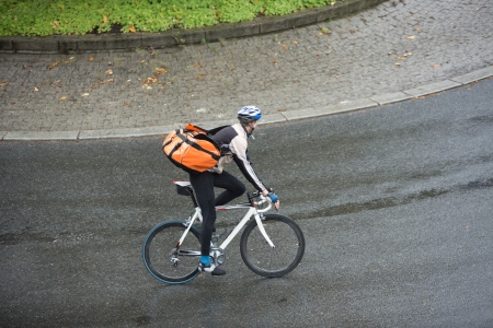 Male Cyclist With Backpack On Street Stock Photo - 16715215