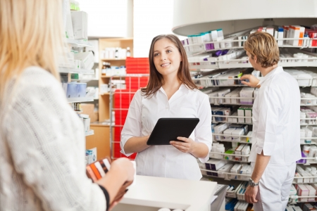 counter service: Pharmacist with Digital Tablet